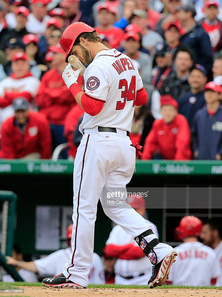 Bryce Harper #34 of the Washington Nationals reacts after striking out looking during the eighth inning against the Atlanta Braves during the Nationals home opener at Nationals Park on April 4, 2014 in Washington, DC. The Braves won 2-1.