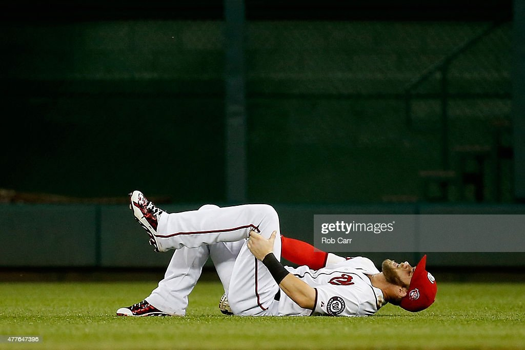 <a gi-track='captionPersonalityLinkClicked' href=/galleries/search?phrase=Bryce+Harper&family=editorial&specificpeople=5926486 ng-click='$event.stopPropagation()'>Bryce Harper</a> #34 of the Washington Nationals reacts on the field after being injured in the sixth inning against the Tampa Bay Rays at Nationals Park on June 18, 2015 in Washington, DC. Harper left the game after the play.