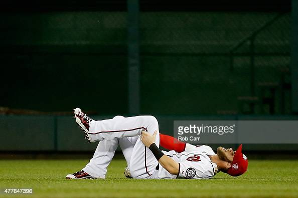 Bryce Harper of the Washington Nationals reacts on the field after being injured in the sixth inning against the Tampa Bay Rays at Nationals Park on...