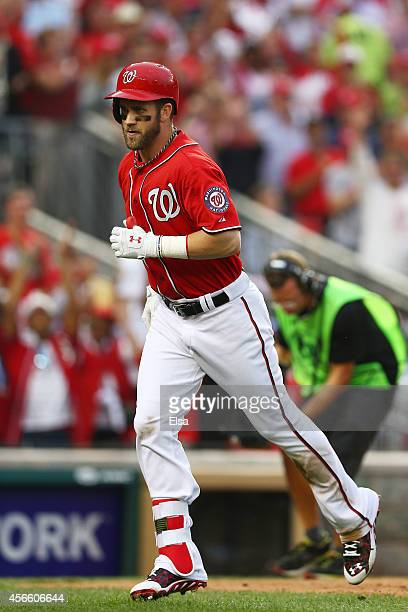Bryce Harper of the Washington Nationals rounds the bases after hitting a home run in the seventh inning against the San Francisco Giants during Game...