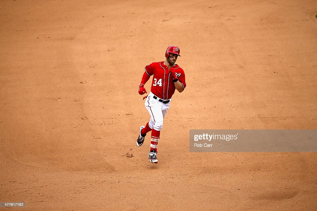 Bryce Harper #34 of the Washington Nationals rounds the bases after hitting a solo home run against the Pittsburgh Pirates in the fourth inning at Nationals Park on June 20, 2015 in Washington, DC.