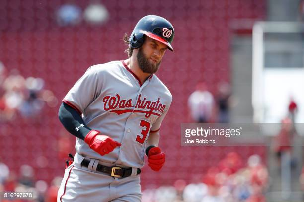 Bryce Harper of the Washington Nationals rounds the bases after a threerun home run in the first inning of a game against the Cincinnati Reds at...