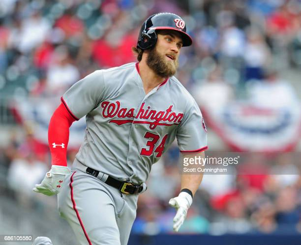 Bryce Harper of the Washington Nationals runs after hitting a single against the Atlanta Braves in the fourth inning at SunTrust Park on May 20 2017...