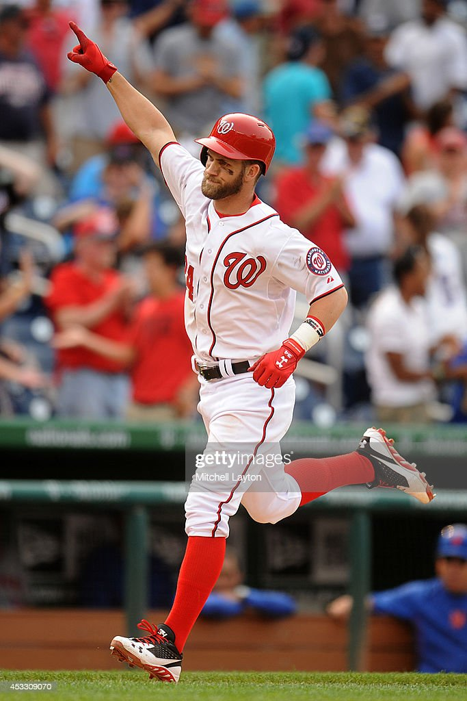 <a gi-track='captionPersonalityLinkClicked' href=/galleries/search?phrase=Bryce+Harper&family=editorial&specificpeople=5926486 ng-click='$event.stopPropagation()'>Bryce Harper</a> #34 of the Washington Nationals runs home after hitting a two run walk off home run in the 13th inning during a baseball game against the New York Mets on August 7, 2014 at Nationals Park in Washington, DC. The Nationals won6-3 in the 13th inning.