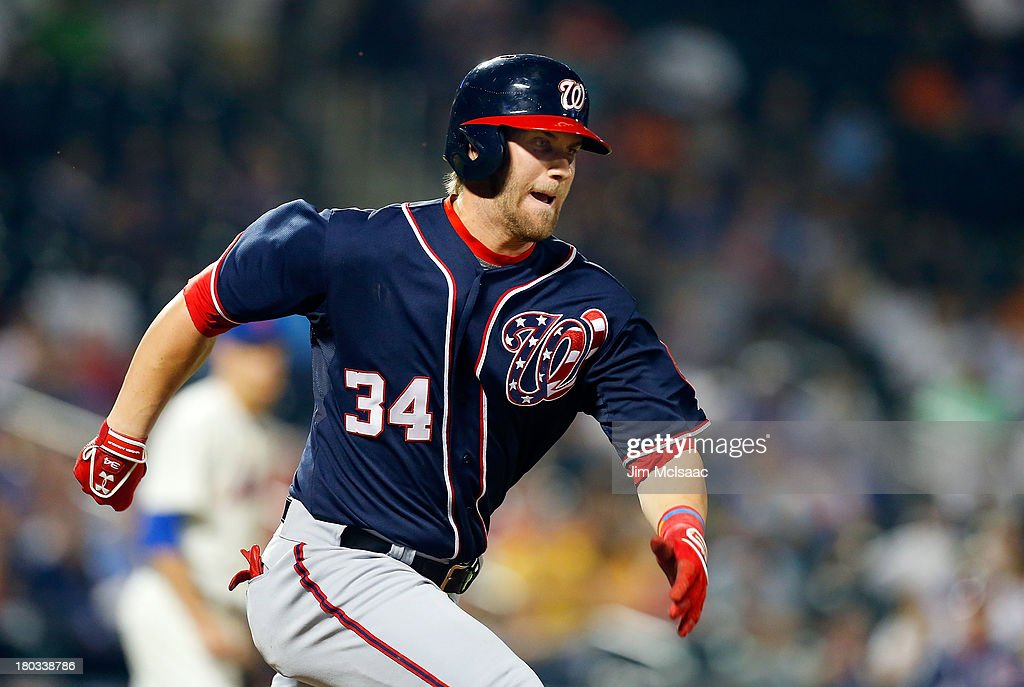 <a gi-track='captionPersonalityLinkClicked' href=/galleries/search?phrase=Bryce+Harper&family=editorial&specificpeople=5926486 ng-click='$event.stopPropagation()'>Bryce Harper</a> #34 of the Washington Nationals runs out a fourth inning infield single against the New York Mets at Citi Field on September 11, 2013 in the Flushing neighborhood of the Queens borough of New York City.