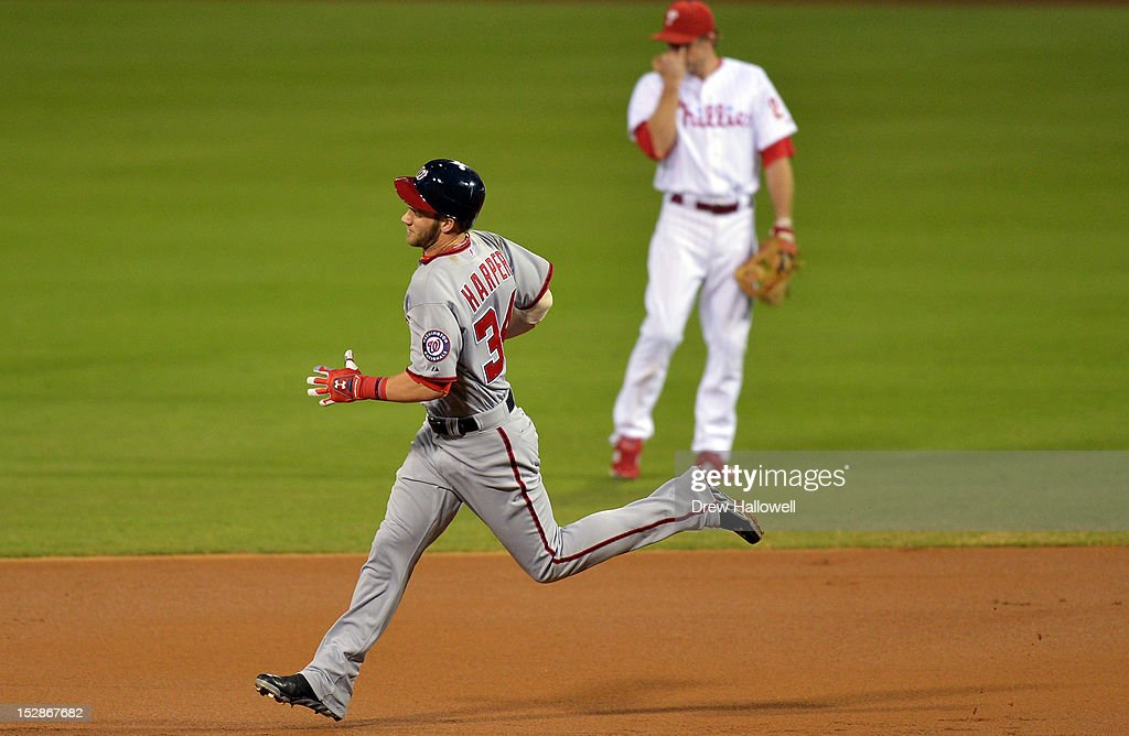 <a gi-track='captionPersonalityLinkClicked' href=/galleries/search?phrase=Bryce+Harper&family=editorial&specificpeople=5926486 ng-click='$event.stopPropagation()'>Bryce Harper</a> #34 of the Washington Nationals runs past <a gi-track='captionPersonalityLinkClicked' href=/galleries/search?phrase=Chase+Utley&family=editorial&specificpeople=161391 ng-click='$event.stopPropagation()'>Chase Utley</a> #26 of the Philadelphia Phillies on a home run at Citizens Bank Park on September 27, 2012 in Philadelphia, Pennsylvania.