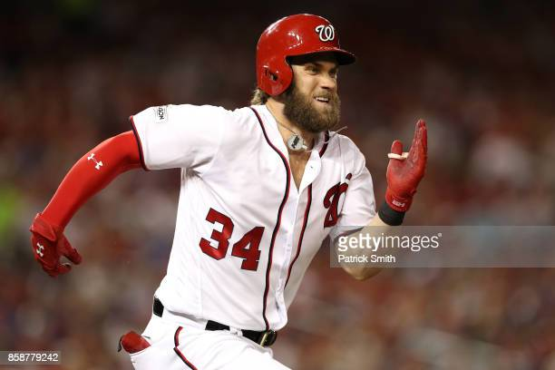 Bryce Harper of the Washington Nationals runs to first against the Chicago Cubs in the sixth inning during game two of the National League Division...