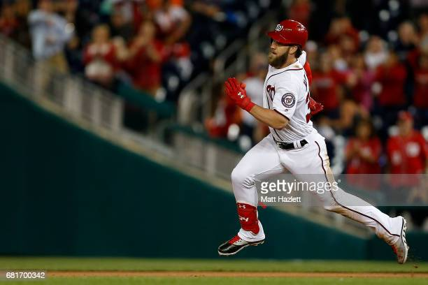 Bryce Harper of the Washington Nationals runs to second base after hitting a double during the ninth inning against the Baltimore Orioles at...