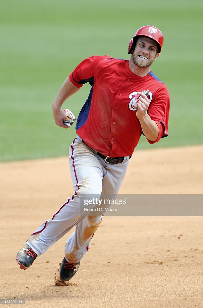 Bryce Harper #34 of the Washington Nationals runs to third base during a spring training game against the Miami Mariins at Roger Dean Stadium on March 26, 3012 in Jupiter, Florida.