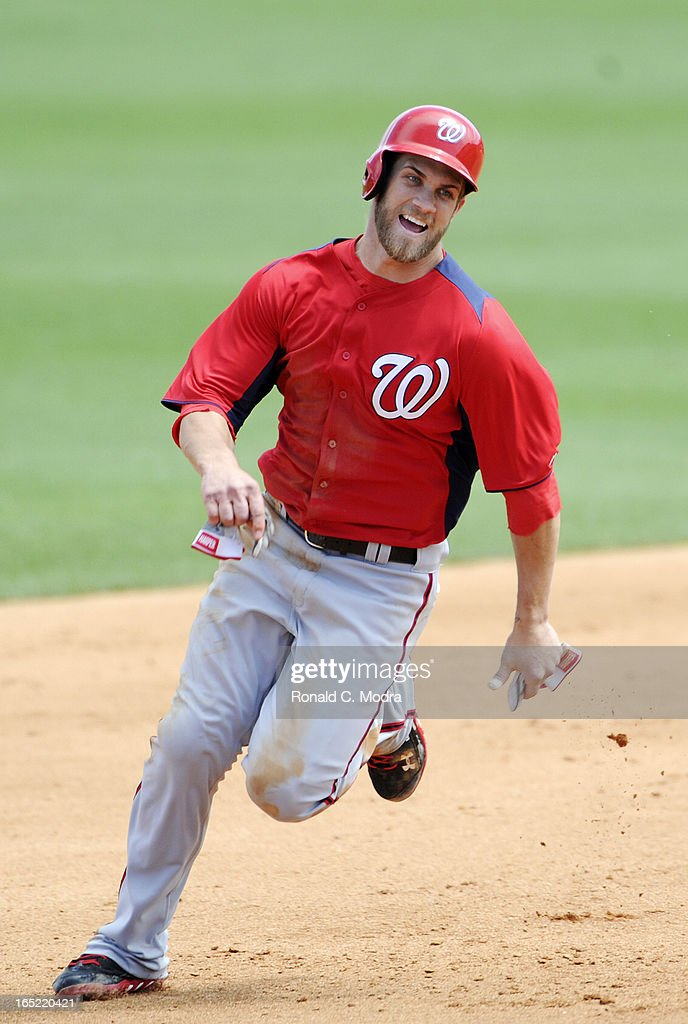 Bryce Harper #34 of the Washington Nationals runs to third base during a spring training game against the Miami Marlins at Roger Dean Stadium on March 26, 3012 in Jupiter, Florida.