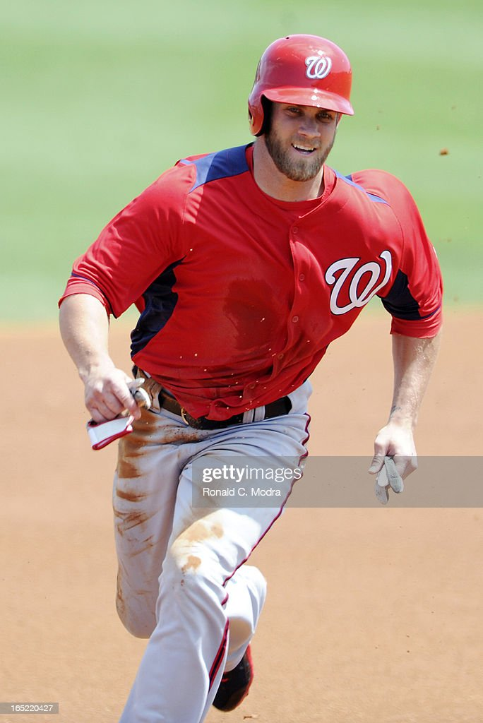 Bryce Harper #34 of the Washington Nationals runs to third base during a spring training game against the Florida Marlins at Roger Dean Stadium on March 26, 3012 in Jupiter, Florida.