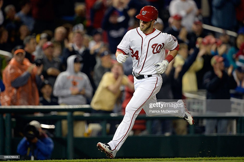 <a gi-track='captionPersonalityLinkClicked' href=/galleries/search?phrase=Bryce+Harper&family=editorial&specificpeople=5926486 ng-click='$event.stopPropagation()'>Bryce Harper</a> #34 of the Washington Nationals runs toward home plate after hitting a solo home run in the fifth inning against the Detroit Tigers during a game at Nationals Park on May 8, 2013 in Washington, DC.