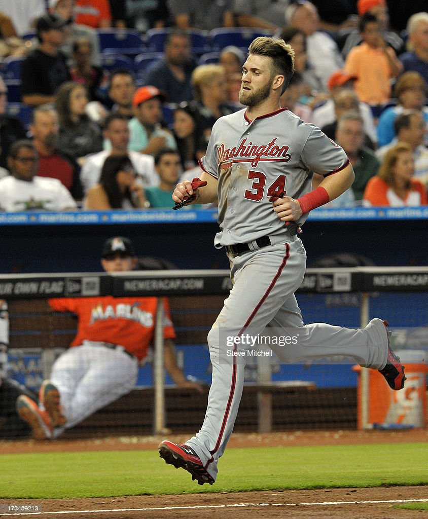 <a gi-track='captionPersonalityLinkClicked' href=/galleries/search?phrase=Bryce+Harper&family=editorial&specificpeople=5926486 ng-click='$event.stopPropagation()'>Bryce Harper</a> #34 of the Washington Nationals scores a run in the seventh inning against the Miami Marlins at Marlins Park on July 14, 2013 in Miami, Florida.