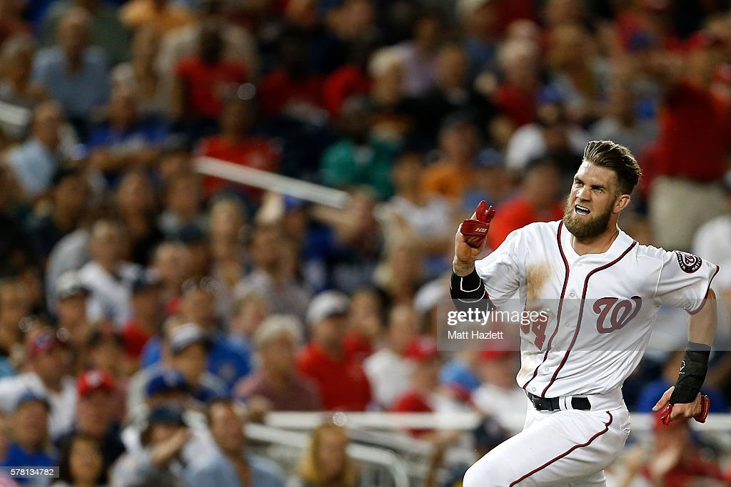 Bryce Harper of the Washington Nationals scores in the sixth inning against the Los Angeles Dodgers at Nationals Park on July 20 2016 in Washington DC