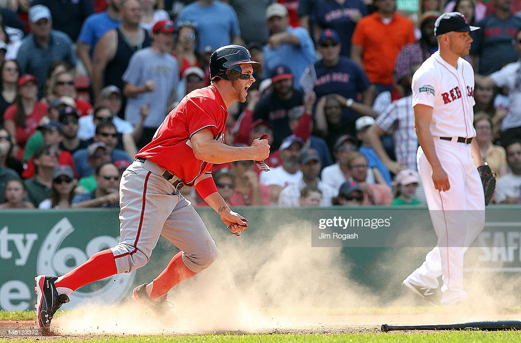 <a gi-track='captionPersonalityLinkClicked' href=/galleries/search?phrase=Bryce+Harper&family=editorial&specificpeople=5926486 ng-click='$event.stopPropagation()'>Bryce Harper</a> #34 of the Washington Nationals scores the go-ahead run in the ninth inning as pitcher <a gi-track='captionPersonalityLinkClicked' href=/galleries/search?phrase=Alfredo+Aceves&family=editorial&specificpeople=5514493 ng-click='$event.stopPropagation()'>Alfredo Aceves</a> #91 of the Boston Red Sox looks away during interleague play at Fenway Park June 10, 2012 in Boston, Massachusetts.