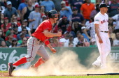 Bryce Harper of the Washington Nationals scores the goahead run in the ninth inning as pitcher Alfredo Aceves of the Boston Red Sox looks away during...