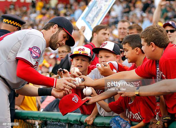 Bryce Harper of the Washington Nationals signs autographs before the game against the Pittsburgh Pirates at PNC Park on July 24 2015 in Pittsburgh...