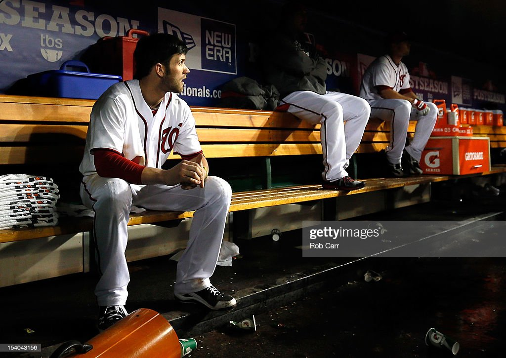 <a gi-track='captionPersonalityLinkClicked' href=/galleries/search?phrase=Bryce+Harper&family=editorial&specificpeople=5926486 ng-click='$event.stopPropagation()'>Bryce Harper</a> #34 of the Washington Nationals sits in the dugout after losing to the St. Louis Cardinals 9-7 in Game Five of the National League Division Series at Nationals Park on October 12, 2012 in Washington, DC.