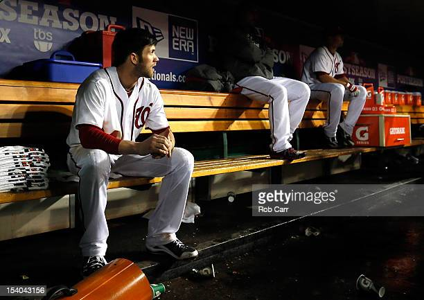 Bryce Harper of the Washington Nationals sits in the dugout after losing to the St Louis Cardinals 97 in Game Five of the National League Division...