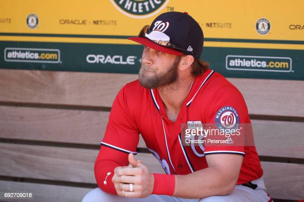 Bryce Harper of the Washington Nationals sits in the dugout before the MLB game against the Oakland Athletics at Oakland Coliseum on June 4 2017 in...