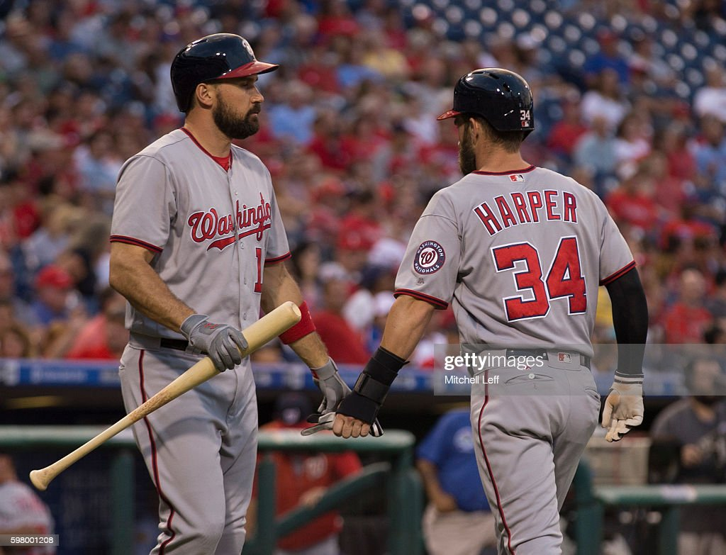 Bryce Harper of the Washington Nationals slaps hands with Ryan Zimmerman after scoring a run in the top of the first inning against the Philadelphia...