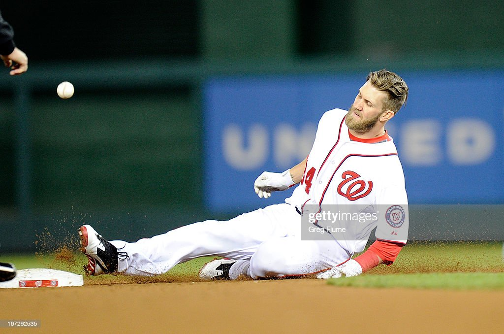 <a gi-track='captionPersonalityLinkClicked' href=/galleries/search?phrase=Bryce+Harper&family=editorial&specificpeople=5926486 ng-click='$event.stopPropagation()'>Bryce Harper</a> #34 of the Washington Nationals slides into second base for a double in the ninth inning against the St. Louis Cardinals at Nationals Park on April 23, 2013 in Washington, DC.