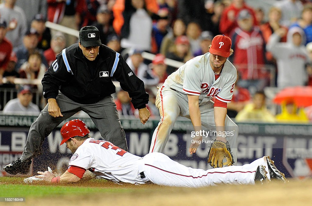 <a gi-track='captionPersonalityLinkClicked' href=/galleries/search?phrase=Bryce+Harper&family=editorial&specificpeople=5926486 ng-click='$event.stopPropagation()'>Bryce Harper</a> #34 of the Washington Nationals slides into third base in the sixth inning ahead of the throw to <a gi-track='captionPersonalityLinkClicked' href=/galleries/search?phrase=Kevin+Frandsen&family=editorial&specificpeople=3982842 ng-click='$event.stopPropagation()'>Kevin Frandsen</a> #28 of the Philadelphia Phillies at Nationals Park on October 1, 2012 in Washington, DC.