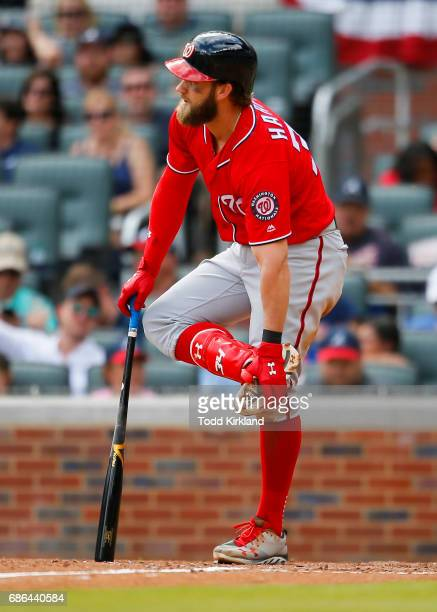 Bryce Harper of the Washington Nationals states his case to an umpire that a ball fouled off his foot that he was called out on in an MLB game...