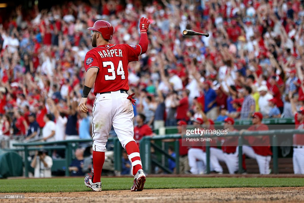 <a gi-track='captionPersonalityLinkClicked' href=/galleries/search?phrase=Bryce+Harper&family=editorial&specificpeople=5926486 ng-click='$event.stopPropagation()'>Bryce Harper</a> #34 of the Washington Nationals tosses his bat after hitting a walk off home run in the ninth inning against the Atlanta Braves at Nationals Park on May 9, 2015 in Washington, DC. The Washington Nationals won, 8-6.