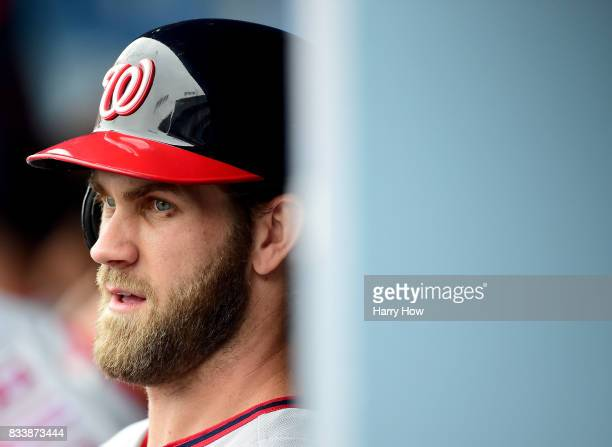 Bryce Harper of the Washington Nationals waits to bat in the dugout during the first inning against the Los Angeles Dodgers at Dodger Stadium on June...