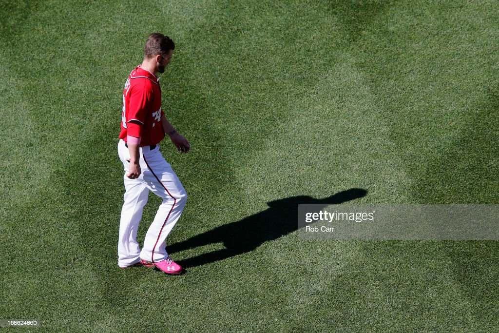 <a gi-track='captionPersonalityLinkClicked' href=/galleries/search?phrase=Bryce+Harper&family=editorial&specificpeople=5926486 ng-click='$event.stopPropagation()'>Bryce Harper</a> #34 of the Washington Nationals walks across the infield after being stranded on base in the eighth inning of the Nationals 2-1 loss to the Chicago Cubs at Nationals Park on May 12, 2013 in Washington, DC.