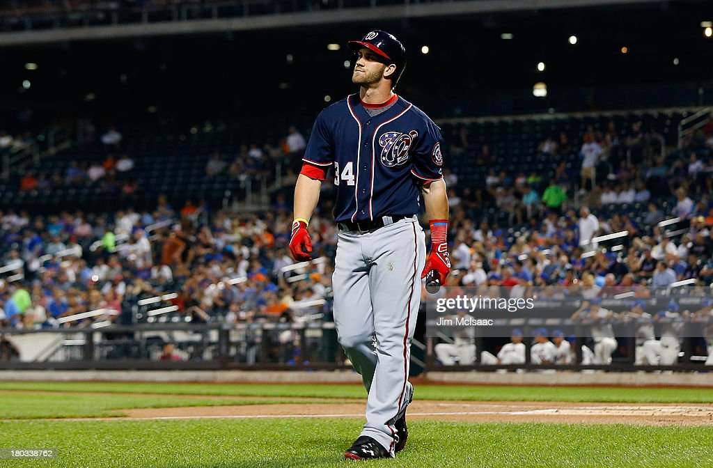 <a gi-track='captionPersonalityLinkClicked' href=/galleries/search?phrase=Bryce+Harper&family=editorial&specificpeople=5926486 ng-click='$event.stopPropagation()'>Bryce Harper</a> #34 of the Washington Nationals walks back to the dugout after striking out in the first inning against the New York Mets at Citi Field on September 11, 2013 in the Flushing neighborhood of the Queens borough of New York City.