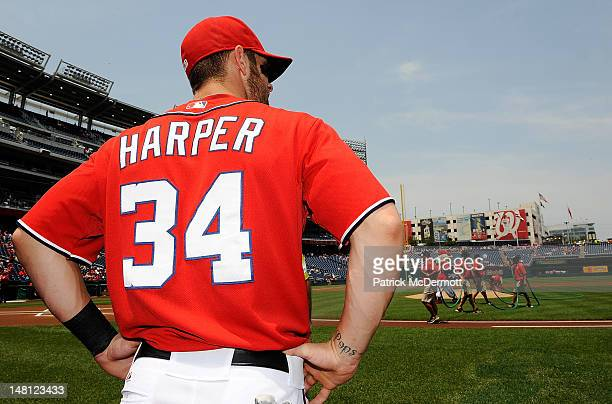 Bryce Harper of the Washington Nationals walks onto the field to receive his AllStar jersey during a ceremony before a game against the Colorado...