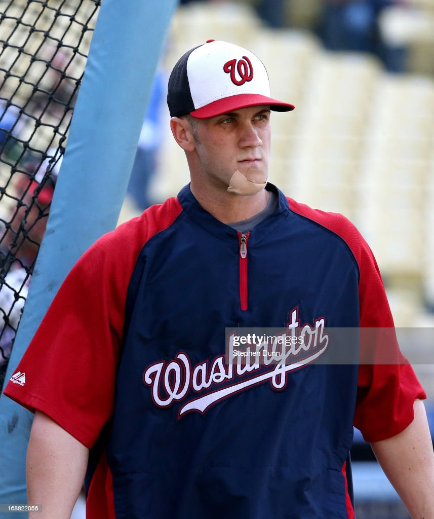 Bryce Harper #34 of the Washington Nationals walks out of the cage as he takes batting practice wearing a bandage on his chin before the game with the Los Angeles Dodgers at Dodger Stadium on May 15, 2013 in Los Angeles, California.