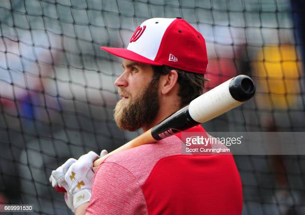 Bryce Harper of the Washington Nationals watches batting practice before the game against the Atlanta Braves at SunTrust Park on April 18 2017 in...