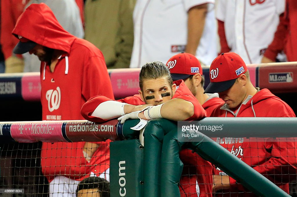 Bryce Harper #34 of the Washington Nationals watches the eighteenth inning against the San Francisco Giants during Game Two of the National League Division Series at Nationals Park on October 4, 2014 in Washington, DC.