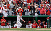 Bryce Harper of the Washington Nationals waves to the crowd after hitting a solo home run against the Miami Marlins during the fourth inning of their...
