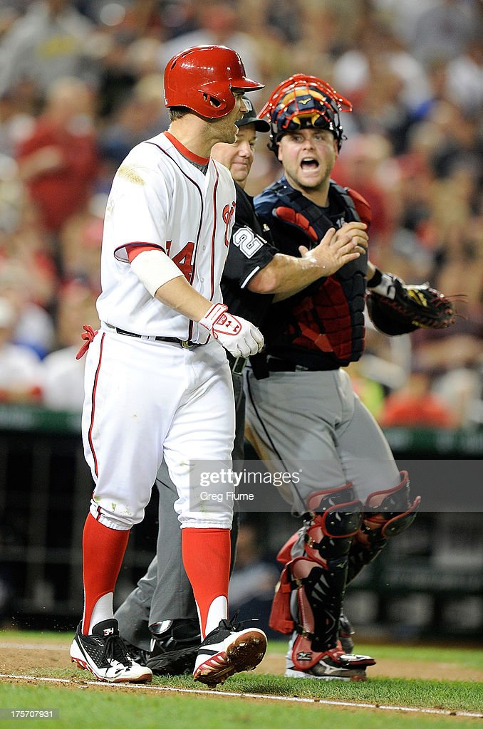 <a gi-track='captionPersonalityLinkClicked' href=/galleries/search?phrase=Bryce+Harper&family=editorial&specificpeople=5926486 ng-click='$event.stopPropagation()'>Bryce Harper</a> #34 of the Washington Nationals yells at <a gi-track='captionPersonalityLinkClicked' href=/galleries/search?phrase=Brian+McCann+-+Baseball+Player&family=editorial&specificpeople=593065 ng-click='$event.stopPropagation()'>Brian McCann</a> #16 of the Atlanta Braves after being hit by a pitch in the fifth inning against at Nationals Park on August 6, 2013 in Washington, DC.