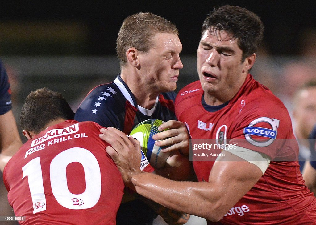 Bryce Hegarty of the Rebels takes on the defence during the Super Rugby trial match between the Queensland Reds and the Melbourne Rebels at Ballymore Stadium on February 14, 2014 in Brisbane, Australia.