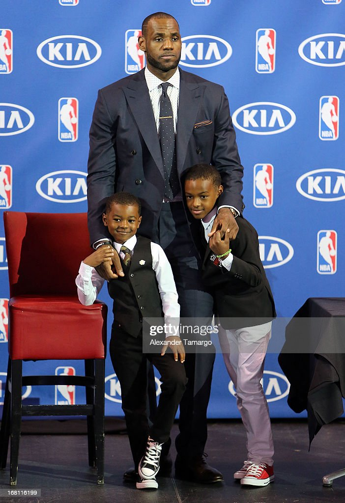 Bryce James, LeBron James and LeBron James Jr attend the LeBron James press confernece to announce his 4th NBA MVP Award at American Airlines Arena on May 5, 2013 in Miami, Florida.