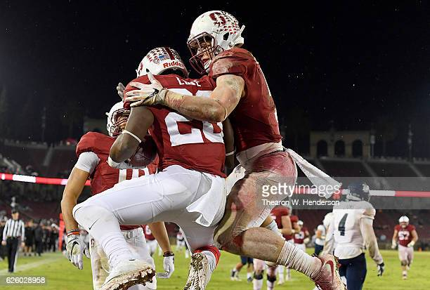 Bryce Love and Christian McCaffrey of the Stanford Cardinal celebrates after Love scored on a fifty yard touchdown run against the Rice Owls in the...