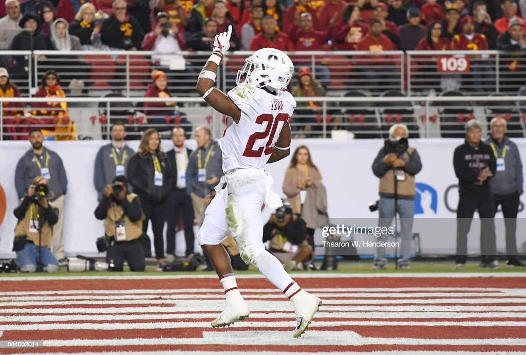 Bryce Love #20 of the Stanford Cardinal celebrates after scoring on a 9-yard touchdown run against the USC Trojans during the Pac-12 Football Championship Game at Levi's Stadium on December 1, 2017 in Santa Clara, California.