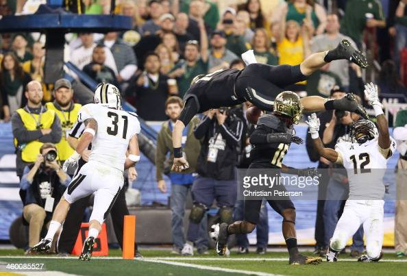Bryce Petty of the Baylor Bears flips into the endzone to score a second quarter touchdown against the defense of Sean Maag and Jacoby Glenn of the...