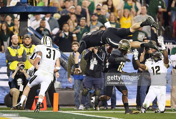 Bryce Petty of the Baylor Bears flips into the end zone to score a second quarter touchdown against the defense of Sean Maag and Jacoby Glenn of the...