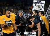 Bryce Petty of the Baylor Bears holds the Big 12 Championship trophy following their victory over Kansas State Wildcats on December 6 2014 at McLane...