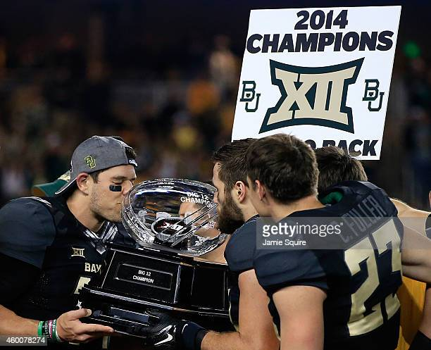 Bryce Petty of the Baylor Bears kisses the Big 12 Championship trophy following their win over Kansas State Wildcats on December 6 2014 at McLane...