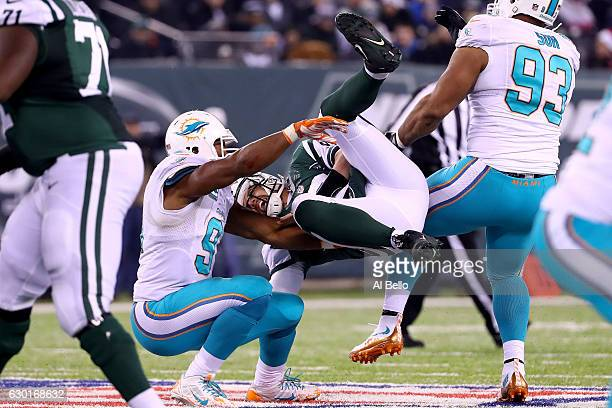 Bryce Petty of the New York Jets gets tackled by Cameron Wake of the Miami Dolphins during the fourth quarter of the game at MetLife Stadium on...