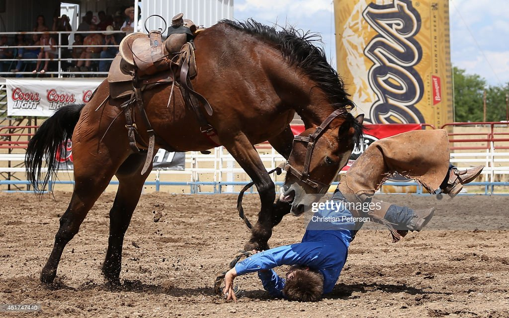 Bryce Quinn is thrown from his horse as he competes in the Bronc Riding at the Prescott Frontier Days 'World's Oldest Rodeo' on July 5, 2014 in Prescott, Arizona.