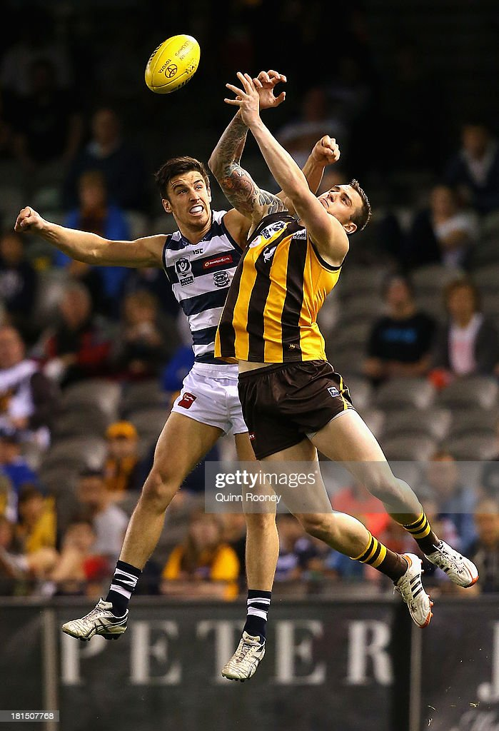 Bryce Retzlaff of the Hawks marks infront of Matthew Sully of the Cats during the VFL Grand Final match between the Box Hill Hawks and the Geelong Cats at Etihad Stadium on September 22, 2013 in Melbourne, Australia.