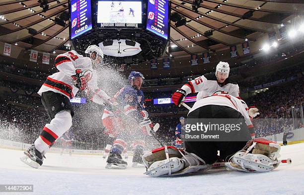 Bryce Salvador Martin Brodeur and Petr Sykora of the New Jersey Devils defend against Ryan Callahan of the New York Rangers in Game Two of the...